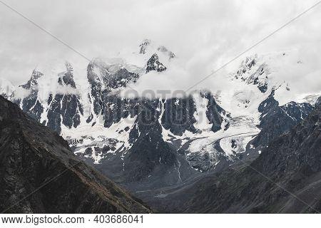 Atmospheric Alpine Landscape With Massive Hanging Glacier On Giant Mountain. Big Glacier Tongue On M