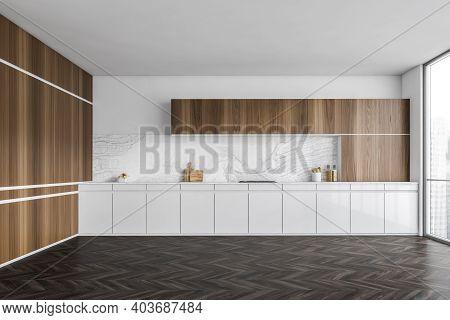 White And Wooden Empty Kitchen Set With Window And Dark Parquet Floor. Modern Luxury Wooden And Whit
