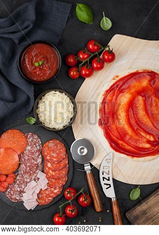 Preparation For Baking Of Pepperoni Pizza With Raw Dough, Salami Spicy Chorizo With Wheel Cutter And