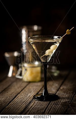 Gibson Alcohol Cocktail With Martini And Onions In Martini Glass. Decorated Cocktail On Dark Backgro