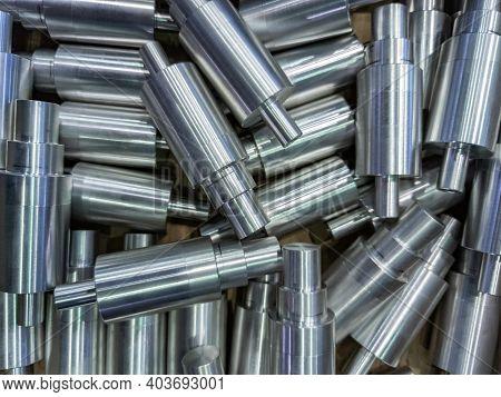 Shiny Cylindrical Aluminium Parts Close-up Full Frame Industrial Background
