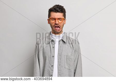 Depressed Displeased Man Cries Unhappily Closes Eyes Feels Upset And Dejected Wears Spectacles And G
