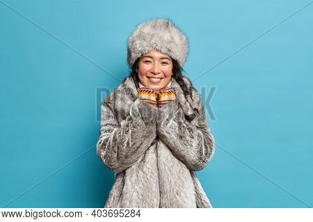 Pretty Young Eskimo Woman With Rouge Cheeks After Spending Time At Frost Smiles Gently Has Two Pigta