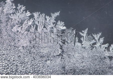 The Image Of Frost On The Glass. Subzero Temperatures Outside. Frozen Water Crystals On Glass. Drawi