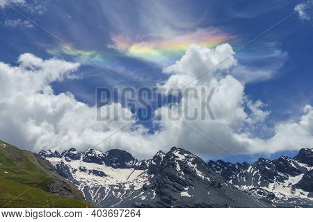 Iridescent Cloud Over The Road To Stelvio Pass, Sondrio Province, Lombardy, Italy, At Summer.