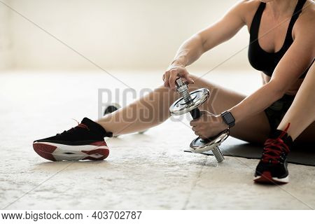 Modern Training Equipment And Exercises For Hand At Home. Slender Middle Aged Muscular Lady Coach In