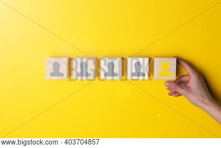 The Hand Holds A Cube Block On A Yellow Background . The Concept Of Hr, Human Resource Management An