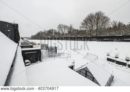 Beautiful Landscape View Of Snowy Backyards Of Townhouses. Winter Backgrounds. Sweden.