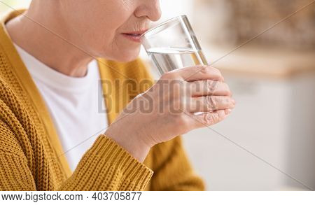 Health Benefits Of Drinking Water Concept. Closeup Of Glass With Spring Water In Old Woman Hand, Sel