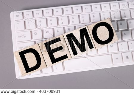 Demo, Text On White Paper On White Keyboard