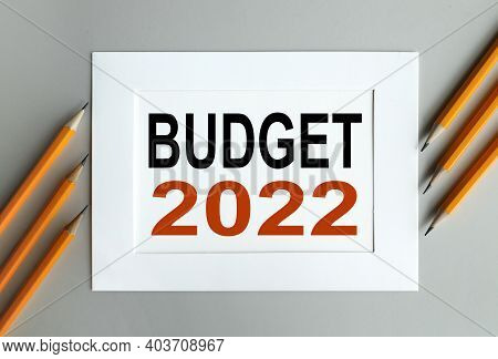 Budget 2022, Text On White Paper In A White Frame On A Gray Background Near The Office