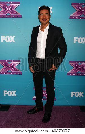 LOS ANGELES - DEC 17:  Mario Lopez at the 'X Factor' Season Finale Press Conference at CBS Television City on December 17, 2012 in Los Angeles, CA
