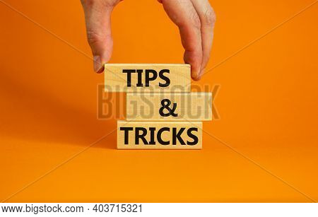 Tips And Tricks Symbol. Wooden Blocks With Words 'tips And Tricks'. Beautiful Orange Background. Bus