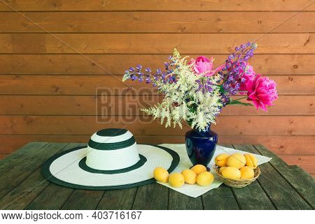 Beautiful Bouquet Made Of White Astilbe, Lupine And Pink Peonies In Blue Vase, Summer Hat And Fresh
