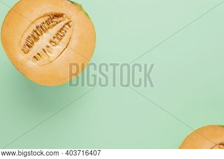 Cantaloupe Melon On A Mint Background, Copy Space.