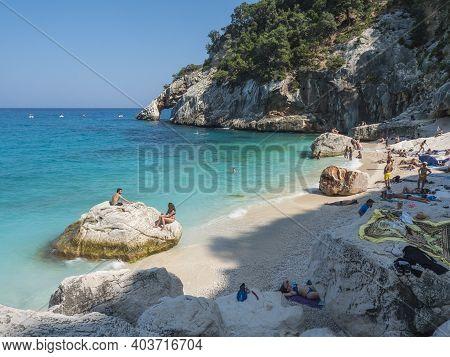Gulf Of Orosei, Sardinia, Italy, September 8, 2020: A View Of Cala Goloritze Beach With Bathing Tour