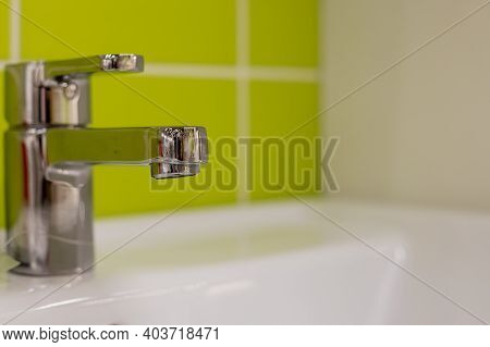 Bathroom Interior With White Sink And Faucet.chrome Bathroom Faucet. Modern Design. Detail Of Sink I