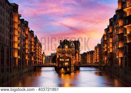 The Warehouse District Speicherstadt During Beautiful Twilight Pink Sunset In Hamburg, Germany. Illu