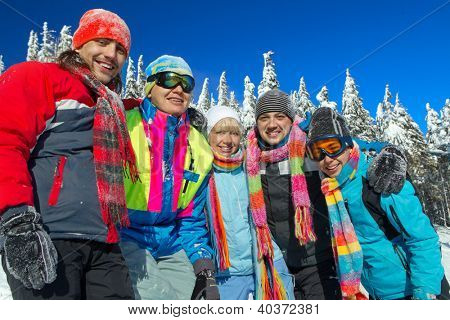 Portrait of group of skiers standing on ski slope