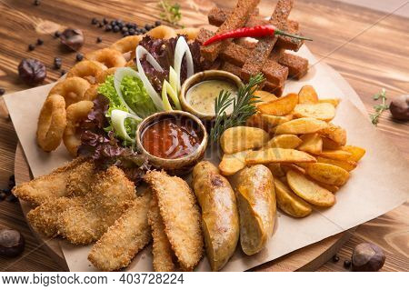 Fried Snack For Beer. Large Plate Of Beer Snacks: Croutons, Fried Onion Rings In Batter, French Frie