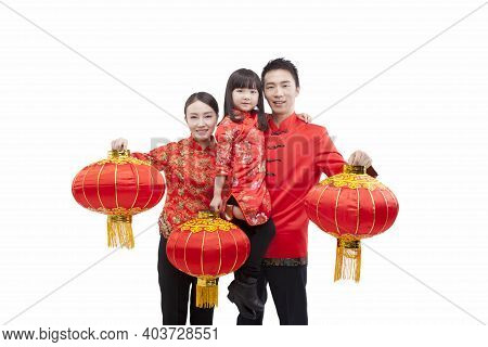 Portrait Of Family, Daughter Holding Red Lantern, Father Carrying Daugther In Arm, Parents Holding R