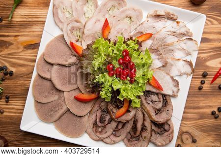Meat Charcuterie Board With Pickled Vegetables And Mustard. Bread, Sauces, Spices For Meat Delicacie