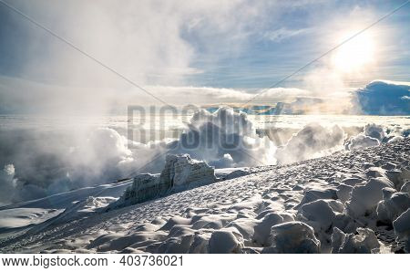 Breathtaking View Of A Overcloud Sunset Sky And Glacier On The 5895m Kilimanjaro Mountain - The High