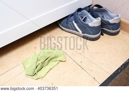 A Microfiber Wipe On A Tile Flor At The Home Enter, Concept Of Cleaning Dirt And Dust Because Of Dur