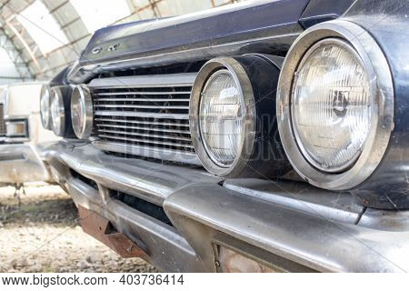 A Headlight Of A Retro Old Car Close Up In A Junk Yard, Recycling Fee Concept