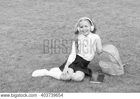 Education Is Safeguard. Cute Girl Listen Music. Happy Preschool Girl With Book In School Yard. Back