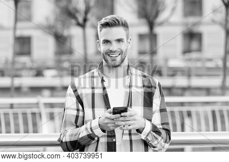 Making Communication Easier. Happy Guy Use Smartphone Outdoors. Mobile Communication. Conversation A