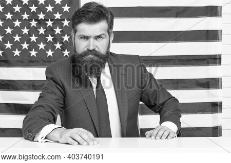 Patriotic Education. Patriotic Man Sit On Usa Flag Background. American Patriot. Independence Day. 4