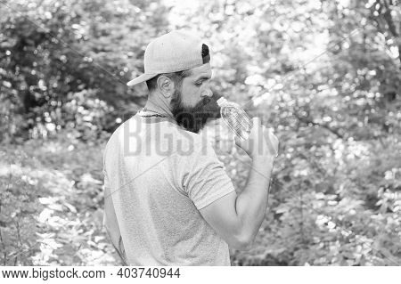Every Sip Counts. Mature Guy In Hat. Thirsty Hipster Traveler. Drinking Water In Forest Outdoor With