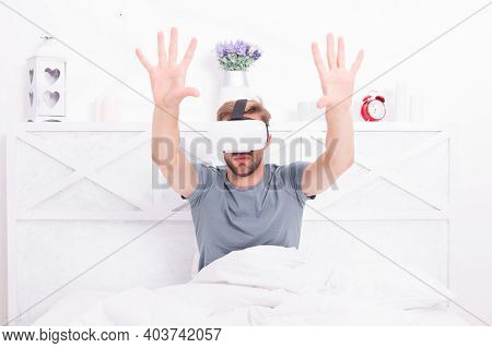 The Best Vr Experience. Handsome Guy Wearing Vr Headset In Bed. Caucasian Man Using Vr Glasses In Be