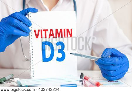 Doctor Holding A White Card In Hands And Pointing The Word Vitamin D3. Healthcare Conceptual For Hos
