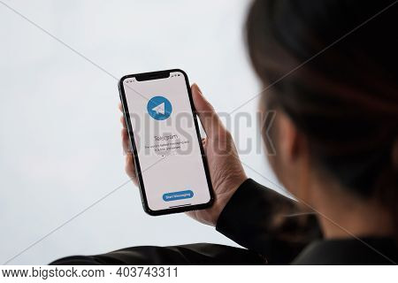 Chiang Mai, Thailand, Jan 18, 2021 : Woman Hand Holding Iphone 12 With Social Networking Service Tel