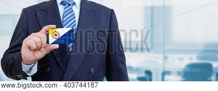 Cropped Image Of Businessman Holding Plastic Credit Card With Printed Flag Of Bonaire. Background Bl