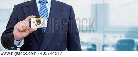 Cropped Image Of Businessman Holding Plastic Credit Card With Printed Flag Of Saint Barthelemy. Back