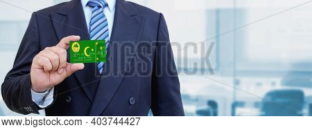 Cropped Image Of Businessman Holding Plastic Credit Card With Printed Flag Of Cocos (keeling) Island