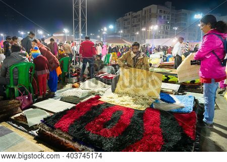 Kolkata, West Bengal, India - 31st December 2018 : Woman Customer Checking Woolen Carpets , Door Mat