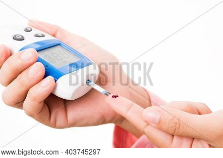 Closeup Hands Woman Measur Glucose Test Level Check With Blood On Finger By Glucometer She Monitor A