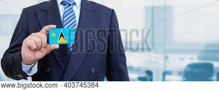 Cropped Image Of Businessman Holding Plastic Credit Card With Printed Flag Of Saint Lucia. Backgroun