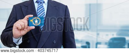 Cropped Image Of Businessman Holding Plastic Credit Card With Printed Flag Of Northern Mariana Islan