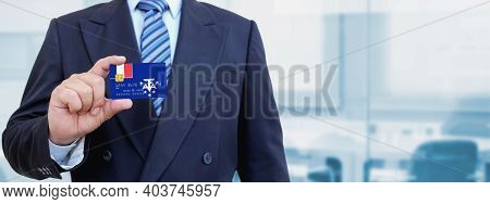 Cropped Image Of Businessman Holding Plastic Credit Card With Printed Flag Of French Southern And An