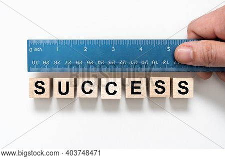 Measure Success Word Using Blue Ruler, Representing A Review, Evaluation Or Assessment Of An Employe