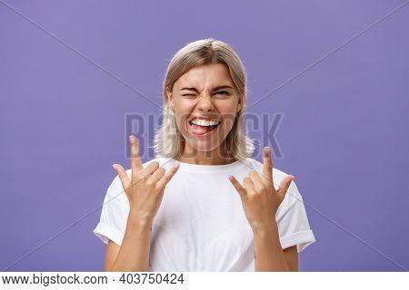 Gonna Rock. Portrait Of Joyful Happy Good-looking Stylish Woman With Blond Medium Haircut Winking Sm