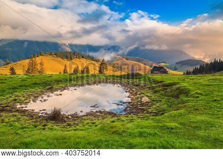 Fantastic Morning Phenomenon In The Mountains With Foggy Hills And Small Lake, Carpathians, Romania,