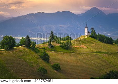 Mountain Scenery With Church On The Mountain Ridge. Colorful Sunset Scenery And Cute Saint Primoz Ch