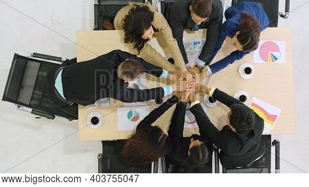Happy Business People Celebrate Teamwork Success Together With Joy At Office Table Shot From Top Vie