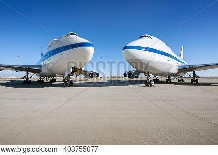 Airplane Parking On An Airport Runway In Sunny Day . Elements Of This Image Furnished By Nasa